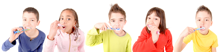 Five children in a row, brushing their teeth