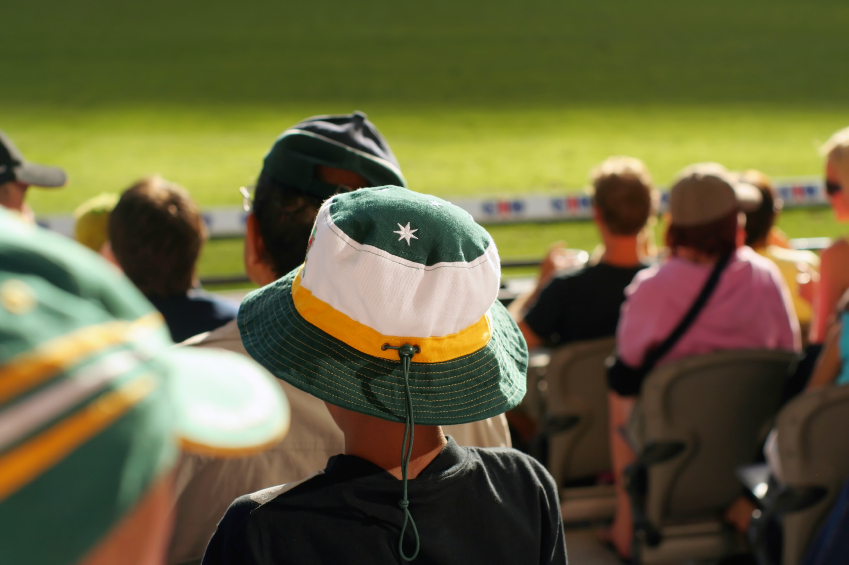 Image of a young Australian spectator watching a match